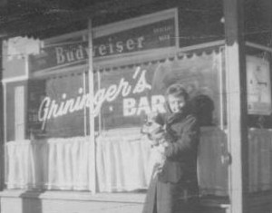 Louise Landsbury in front of Grininger's Bar