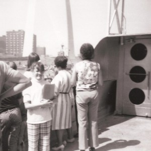 Linda Tate on the S.S. Admiral with the Gateway Arch in the background
